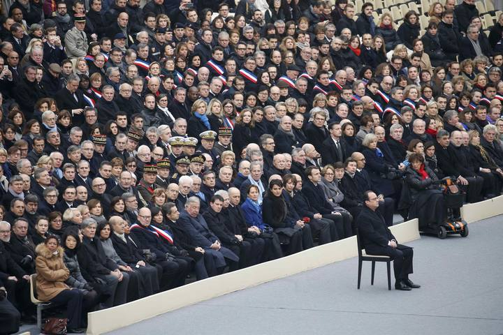 French President Francois Hollande sits in front of members of the French government, officials and guests during a ceremony to pay a national homage to the victims of the Paris attacks at Les Invalides monument in Paris, France, November 27, 2015. REUTERS/Charles Platiau